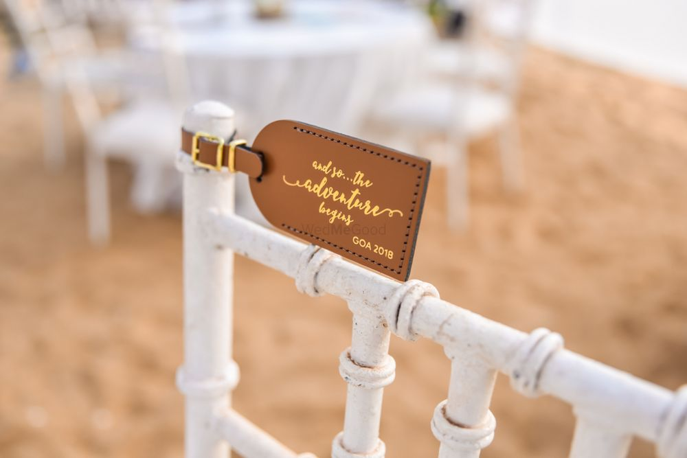 Photo of Luggage tags as favours on chairs