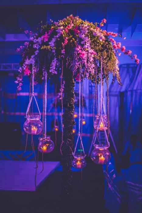 Photo of large tree style table centepieces with hanging candles on cocktail night