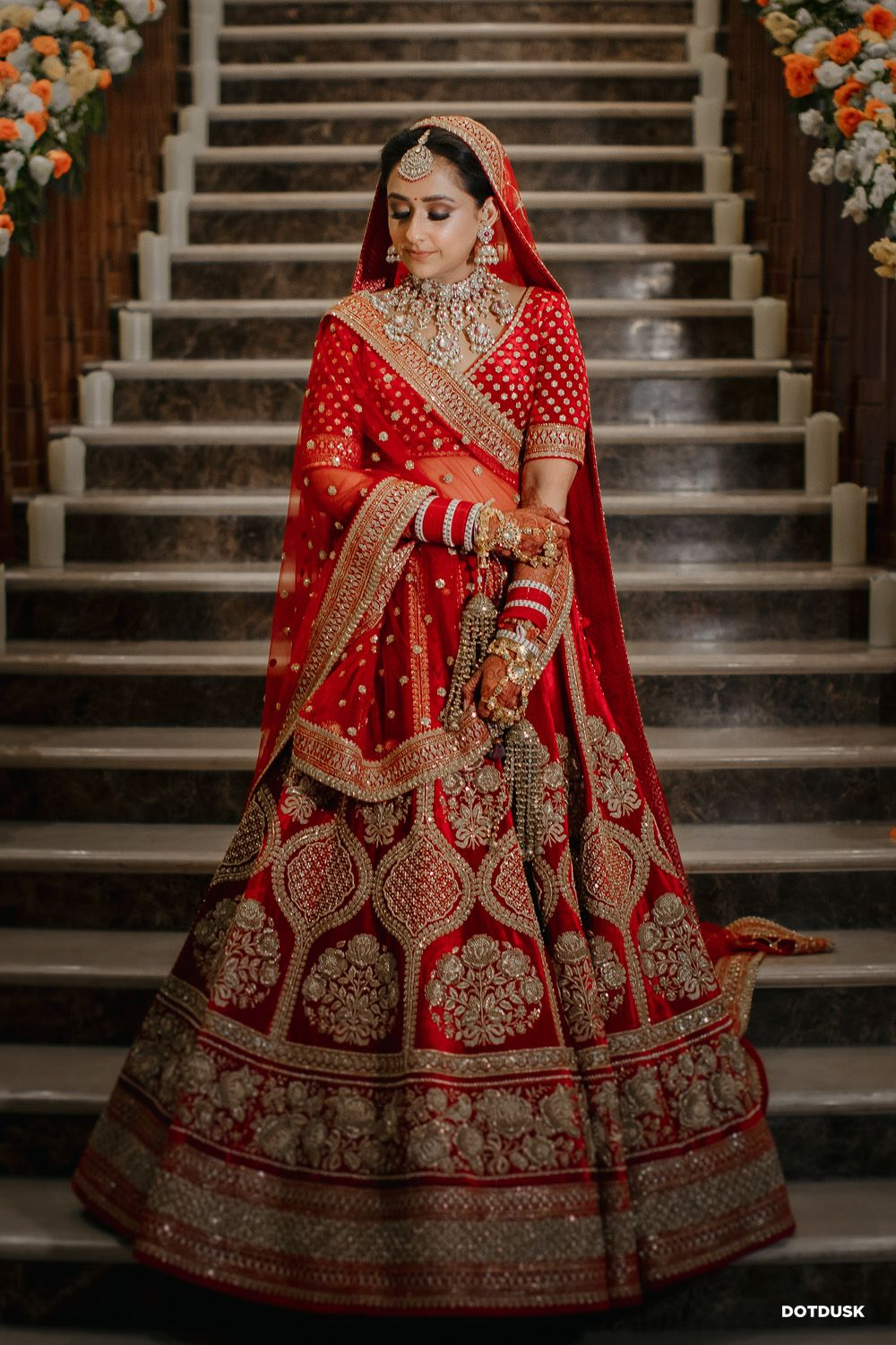 Photo of Bride in a red lehenga