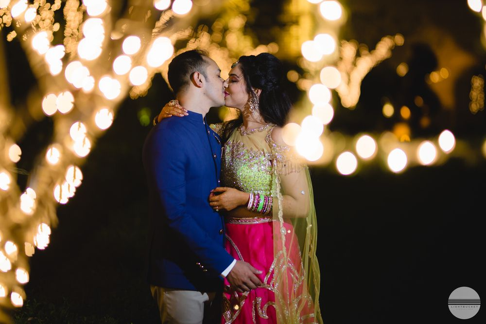 Photo of Romantic couple kissing shot with fairy lights