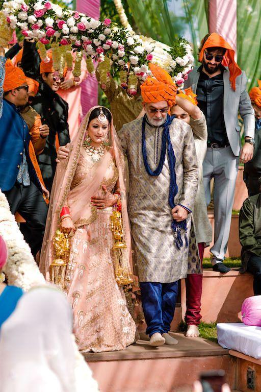 Photo of Bride entering with father under phoolon ki chadar