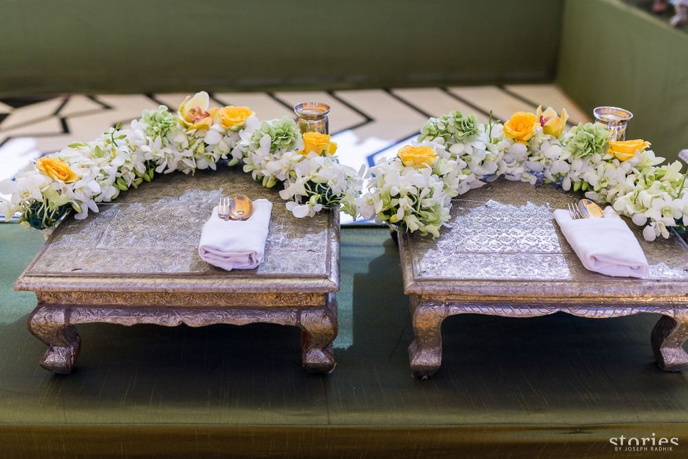 Photo of Food serving ideas with marigold flowers at Indian wedd