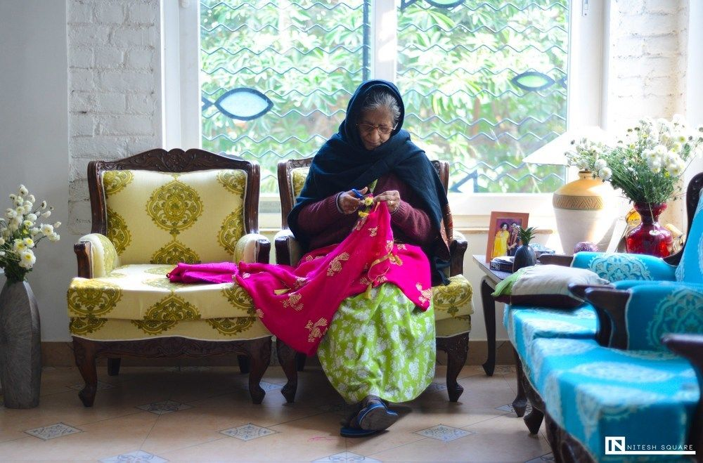 Photo of Brides grandma stitching dupatta