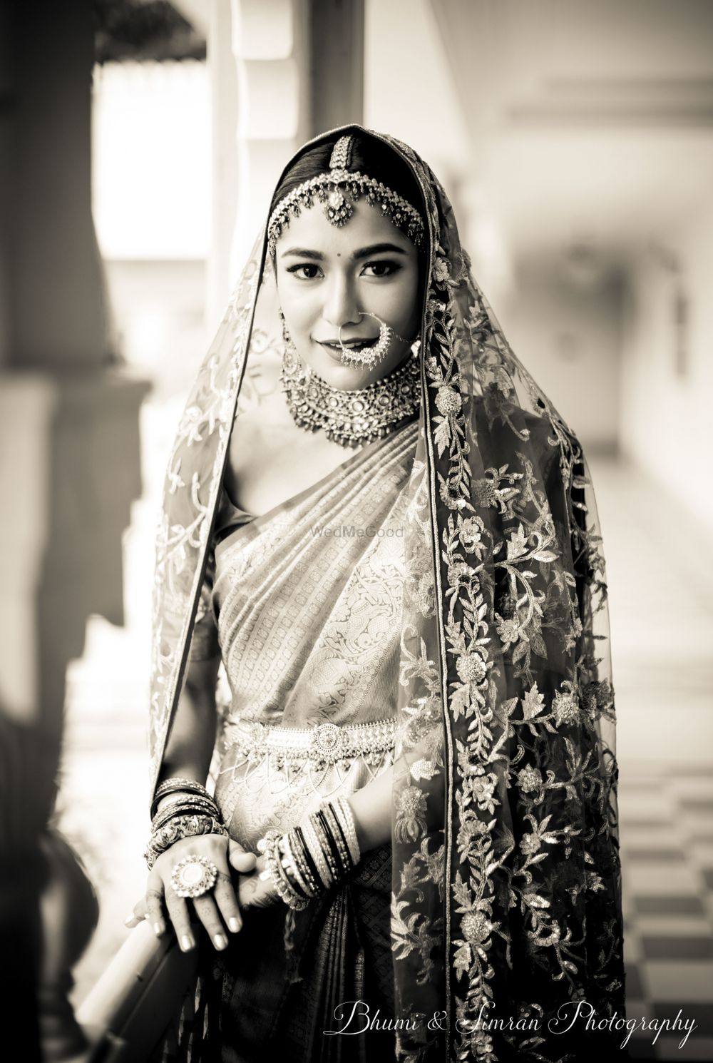 Photo of Bride with saree and dupatta on wedding day black and white photo