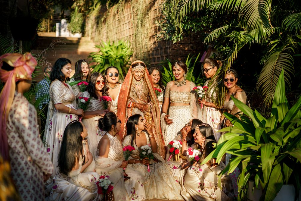 Photo of bride with her matching bridesmaids on her wedding day