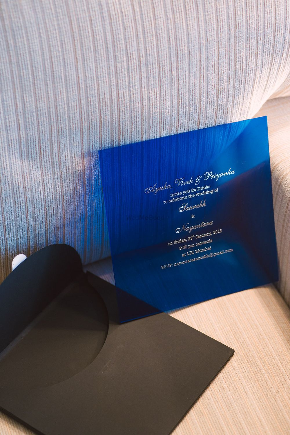 Photo of blue invitation card