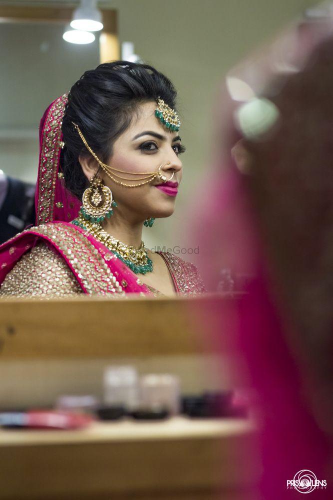 Photo of bride looking in mirror