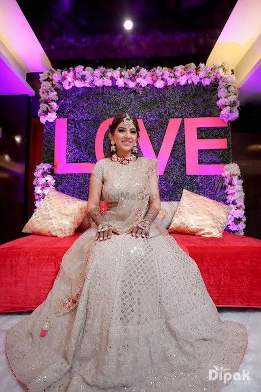 Photo of Bride to be in beige for her mehendi