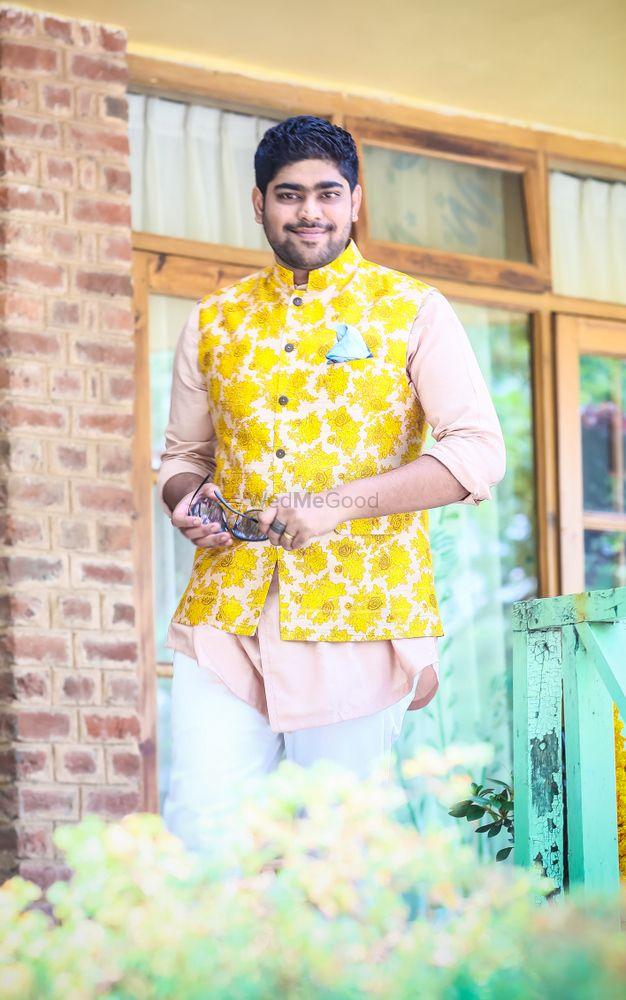 Photo of Yellow nehru jacket with kurta on mehendi