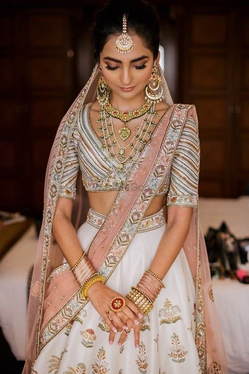 Photo of Simple bridal look with ivory lehenga and subtle makeup