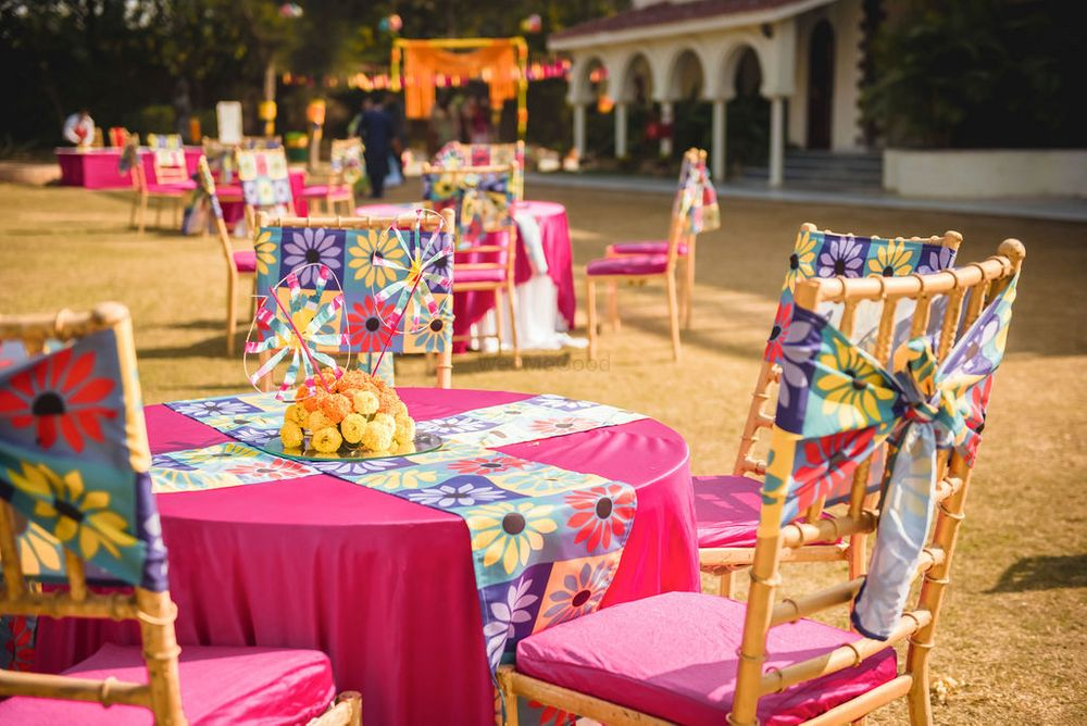 Photo of Mehendi decor with pink and orange table setting