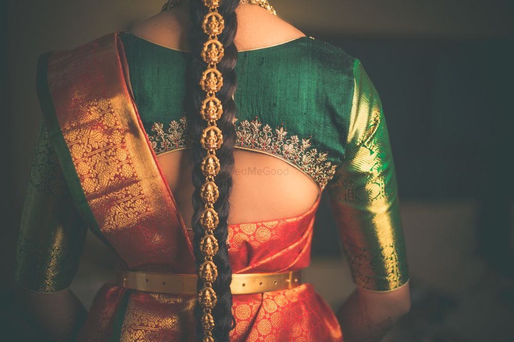 Photo of South Indian bridal hairstyle and blouse back shot