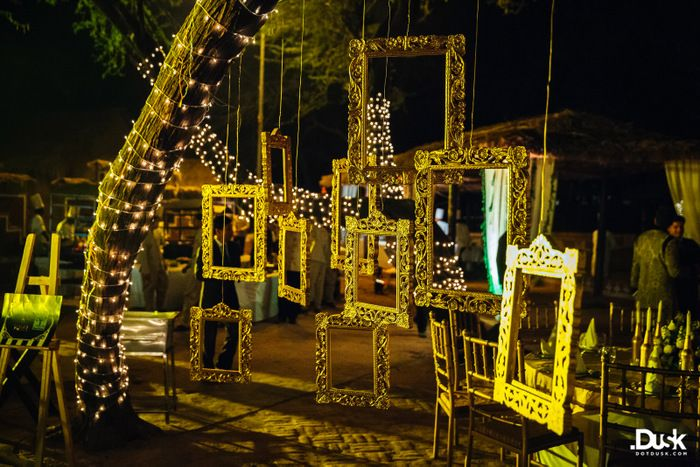Photo of Hanging gold frames from tree for sangeet or cocktail night decor