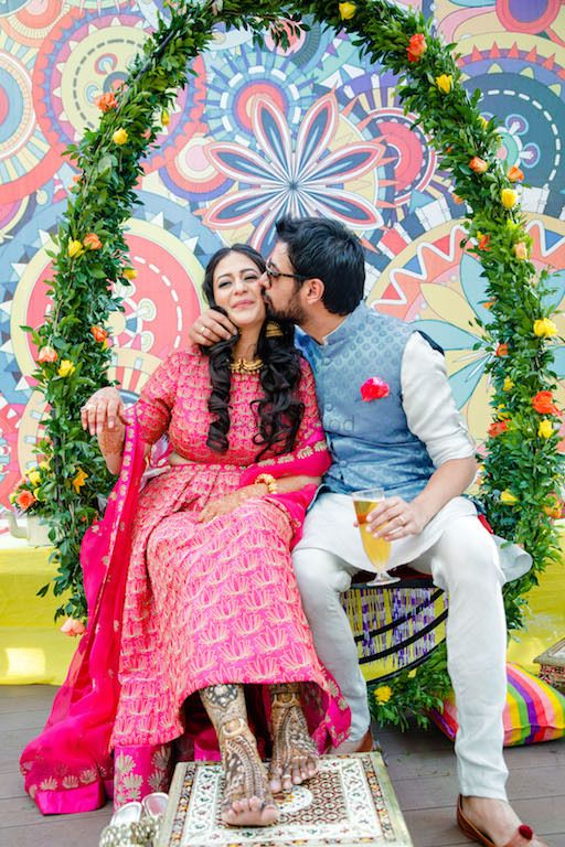 Photo of Mehendi swing decor with cute couple portrait
