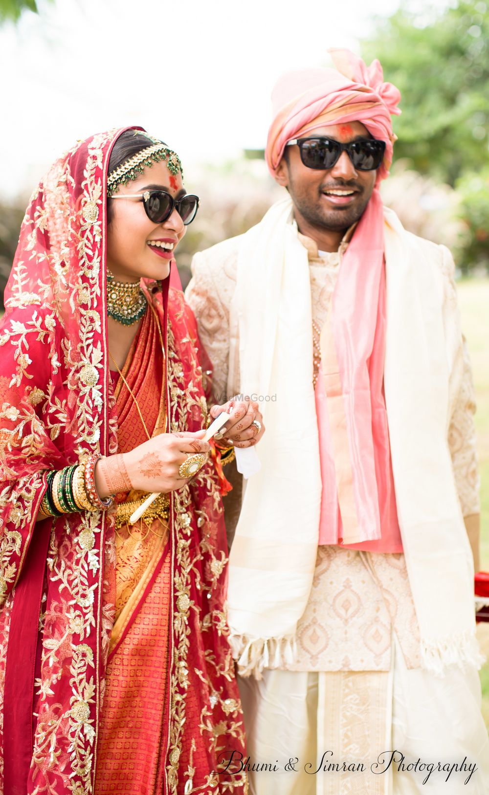 Photo of Cool couple shot wearing sunglasses for day wedding