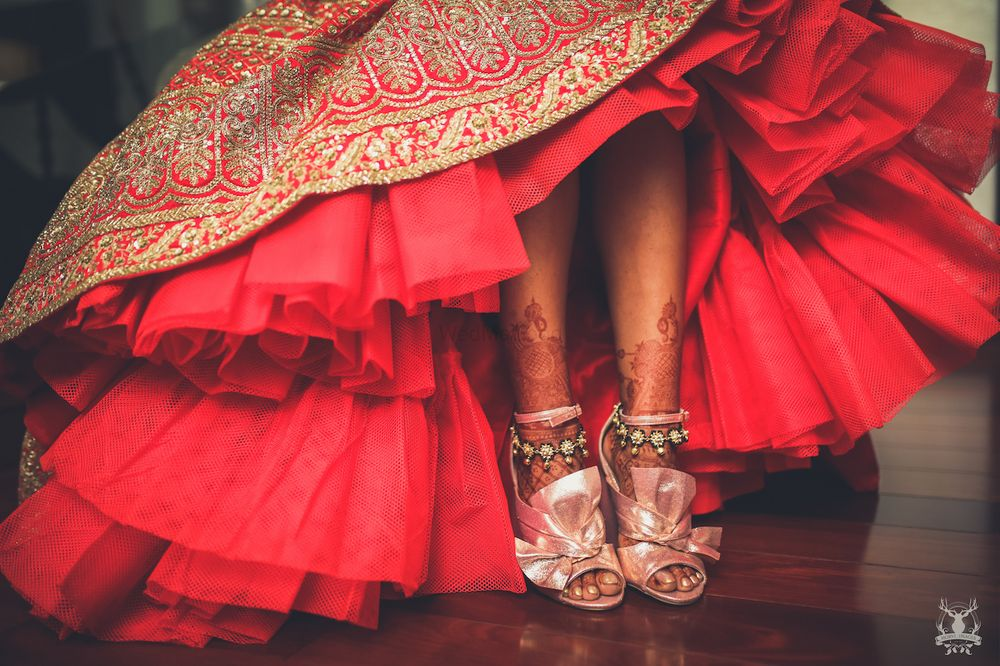Photo of Red bridal lehenga with can can and unique shoes