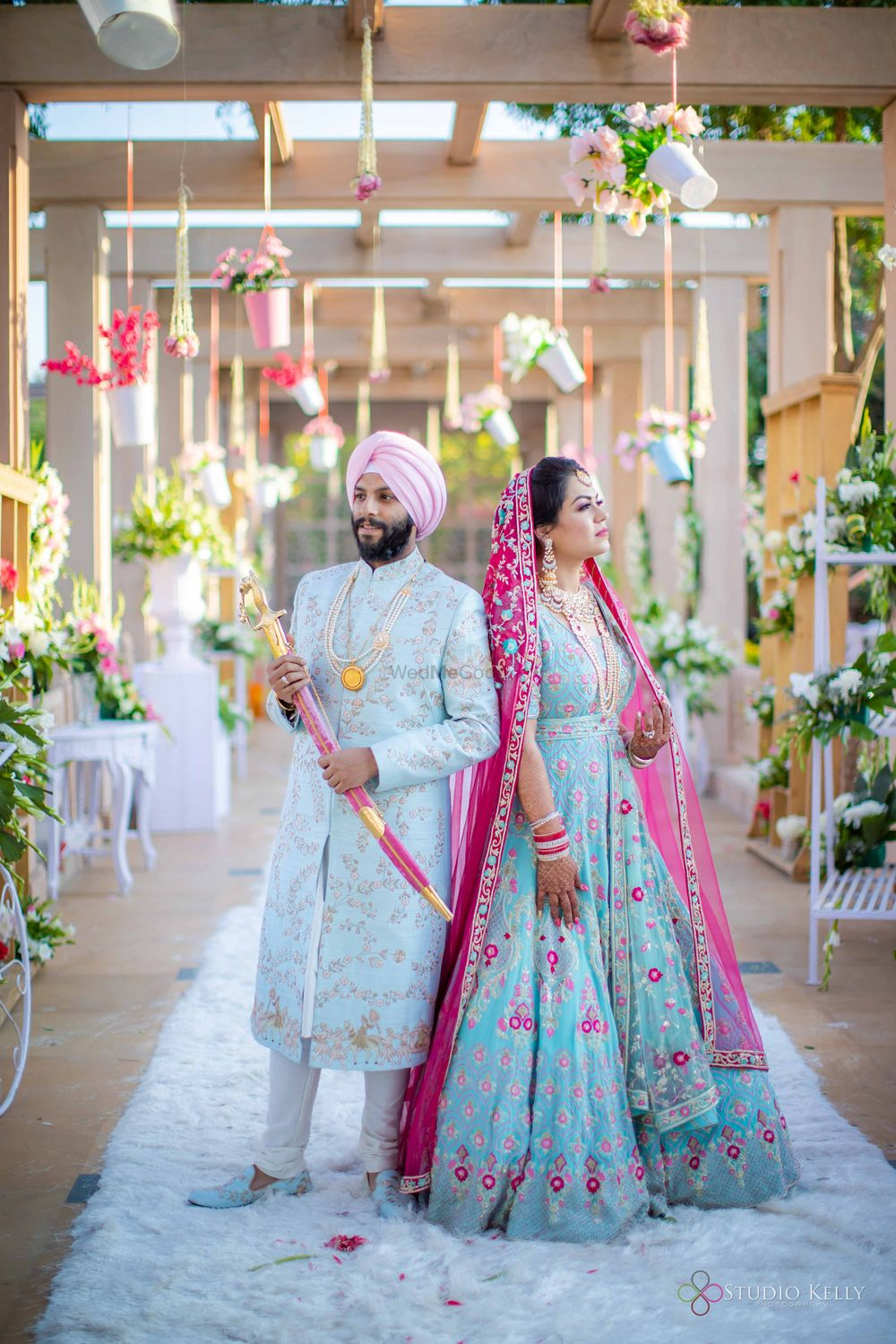 Photo of sikh couple shot with both of them in powder blue outfits