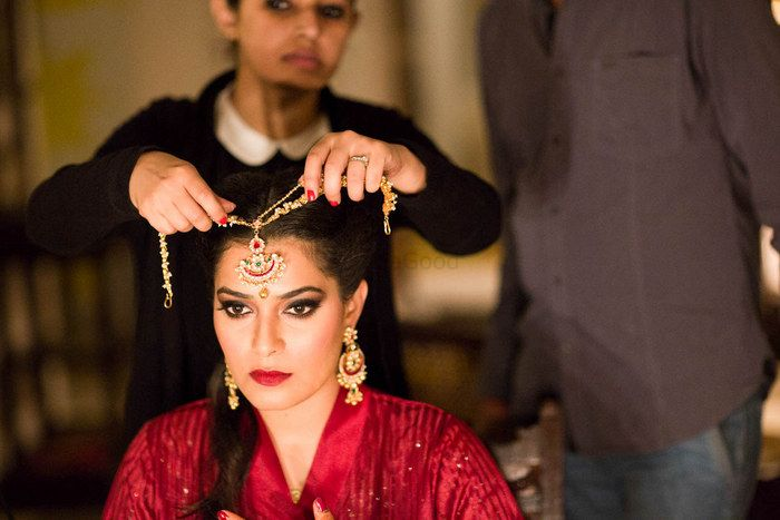 Photo of Bride Wearing Gold Double String Mathapatti