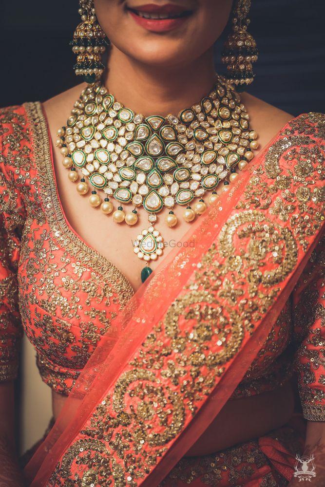 Photo of Peach bridal lehenga with choli cut blouse and polki necklace