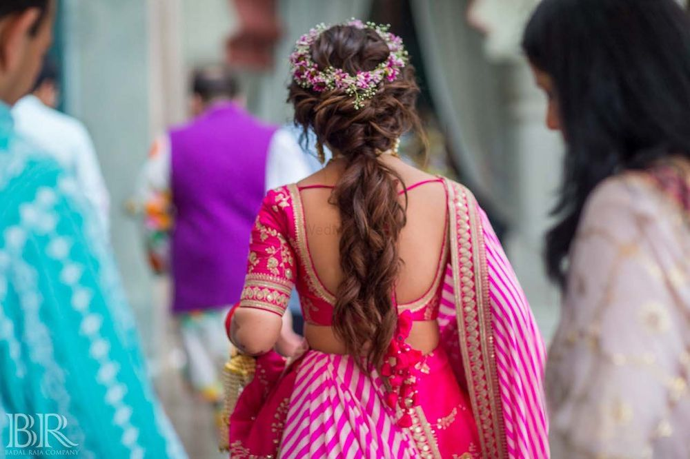 Photo of Mehendi hairdo with ponytail and floral wreath