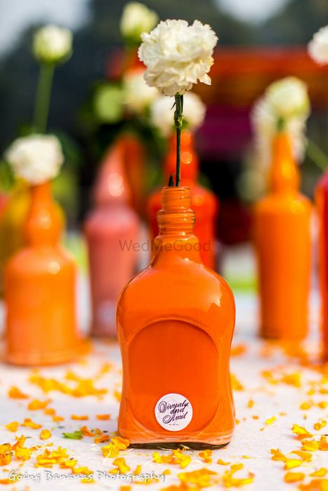 Photo of handpainted bottles as table center pieces
