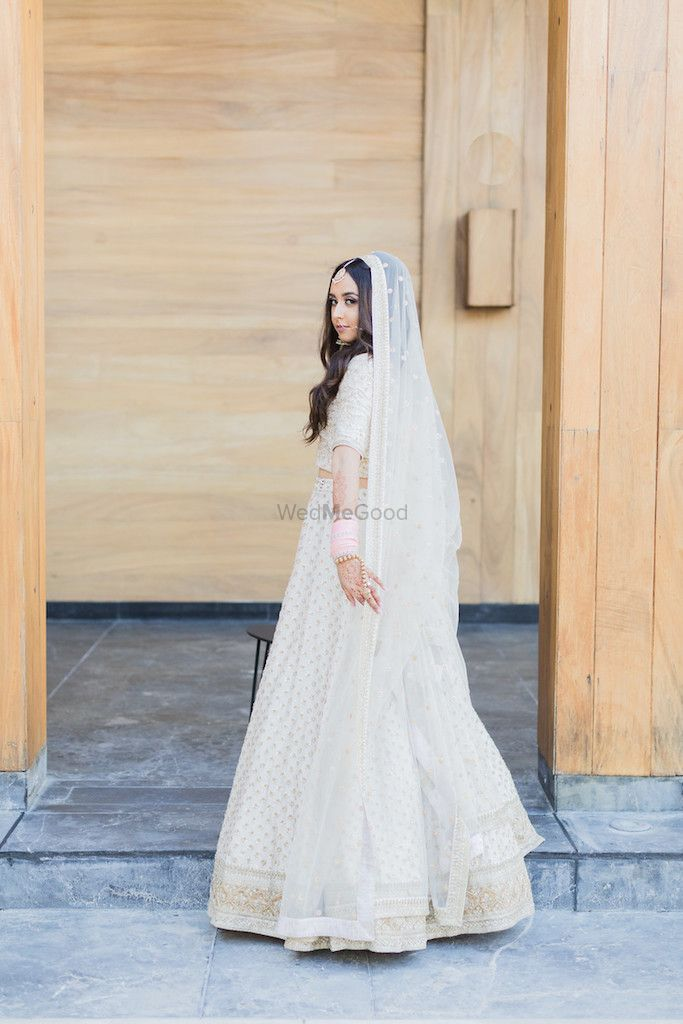 Photo of Offbeat bride in white with open hair