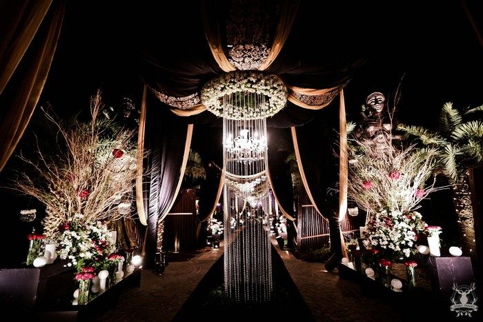 Photo of glamorous black and gold cocktail theme with drapes