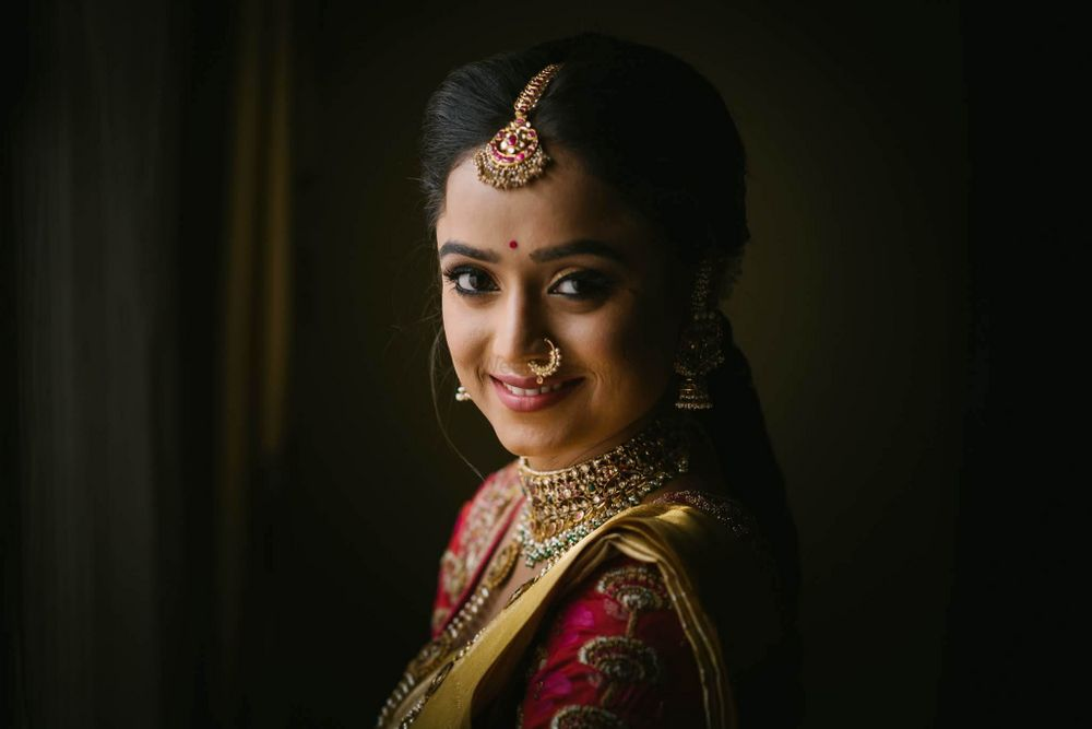 Photo of Happy bridal posing in beautiful gold jewellery.
