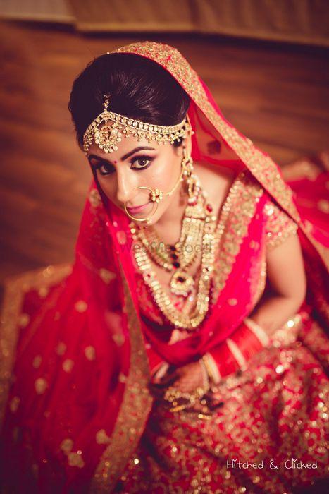 Photo of Bride in pink lehenga