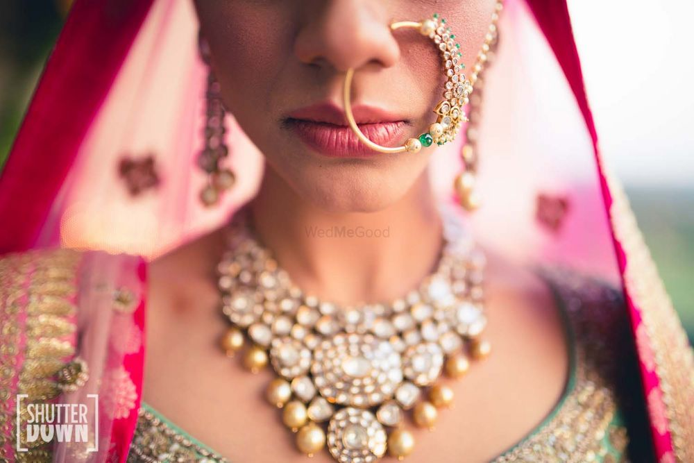 Photo of Green bridal Nath and bib necklace