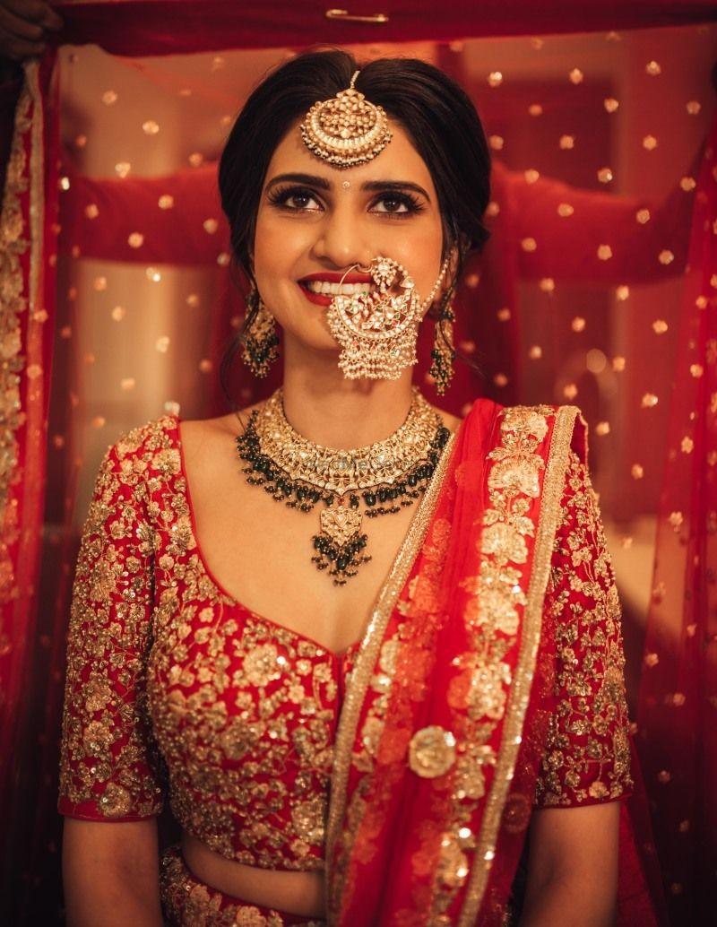 Photo of Bride getting ready dupatta placing on head shot