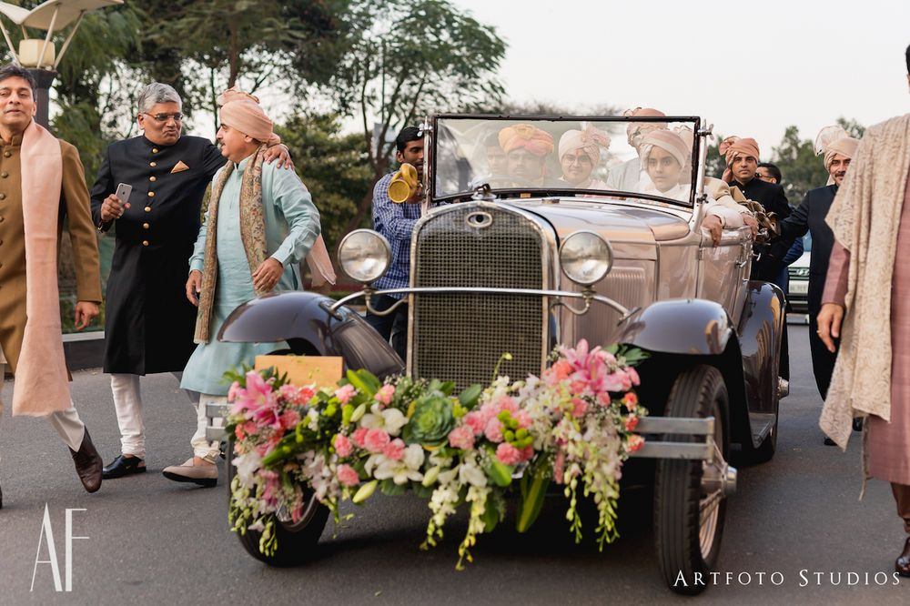 Photo of Grooms entry in a vintage car