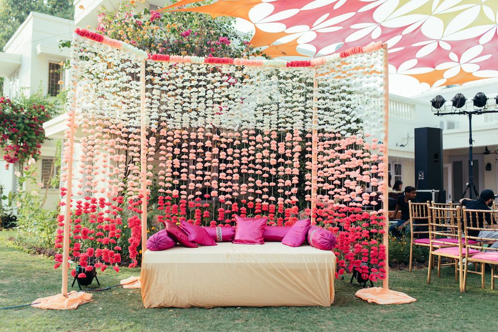 Photo of Ombre floral string backdrop for mehendi