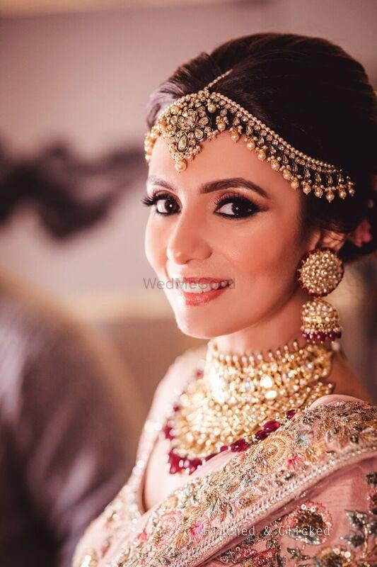 Photo of Subtle pink makeup on bride