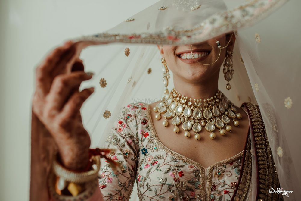 Photo of bridal veil shot in white lehenga