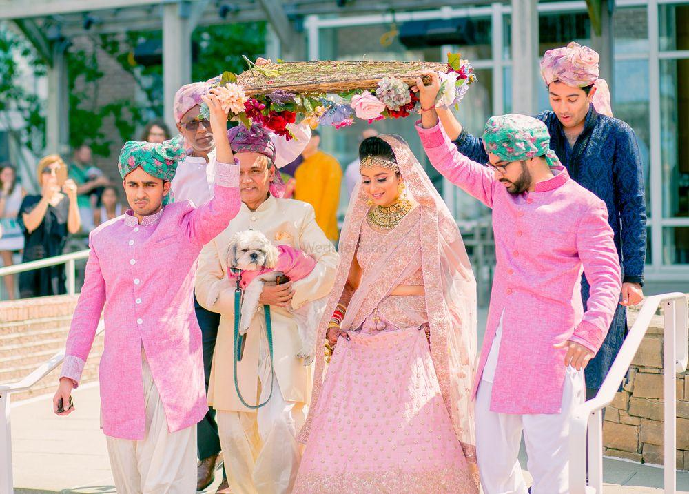 Photo of Bride entering under dried floral phoolon ki chadar