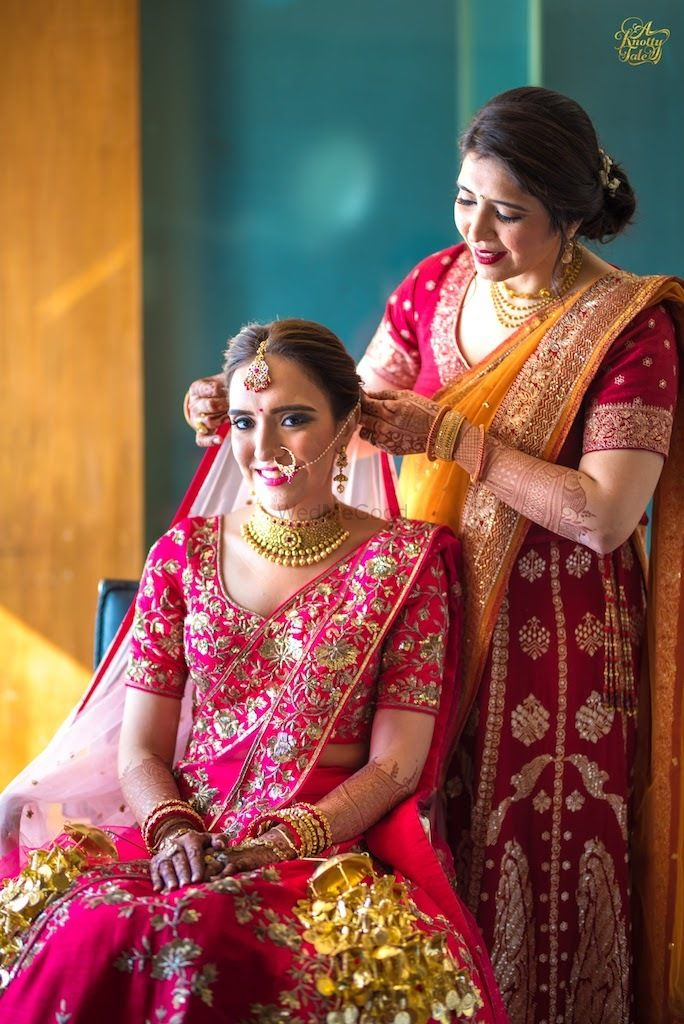 Photo of Bride getting ready shot with her mother