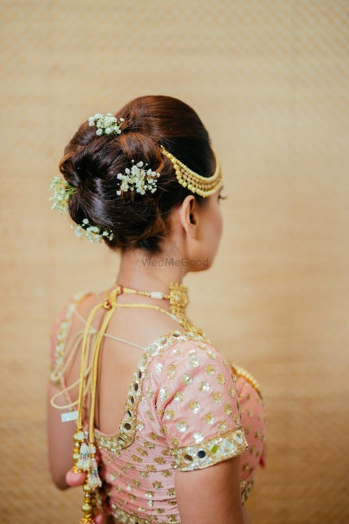Photo of Simple bridal bun with babys breath