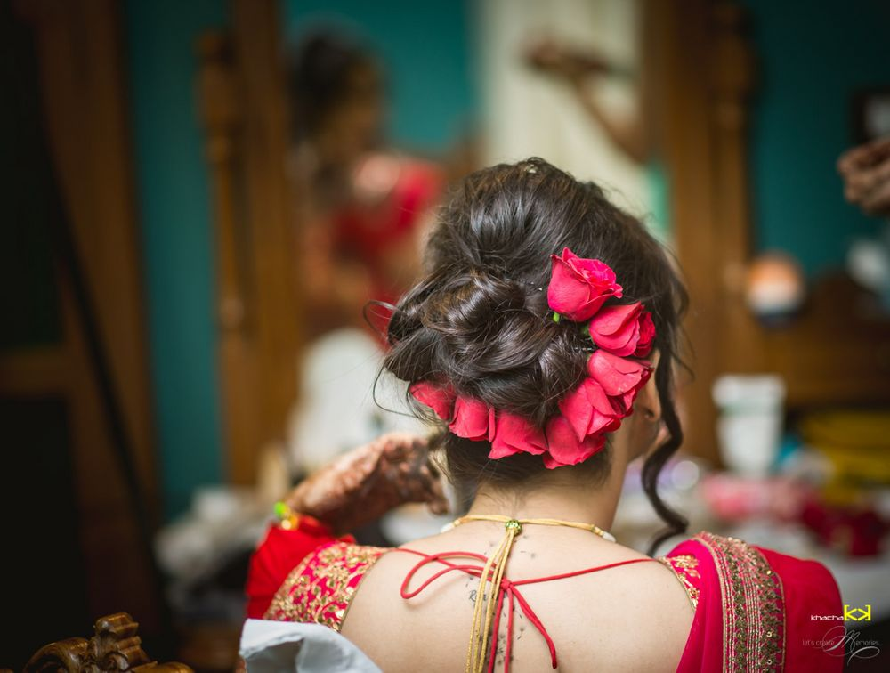 Photo of Bridal bun with red roses