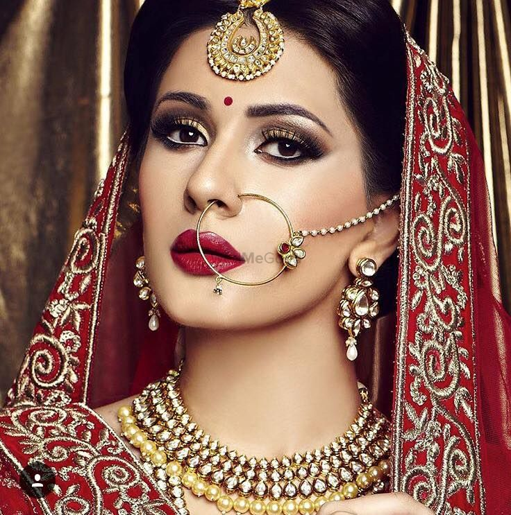 Photo of Red and gold bridal makeup with smokey eye