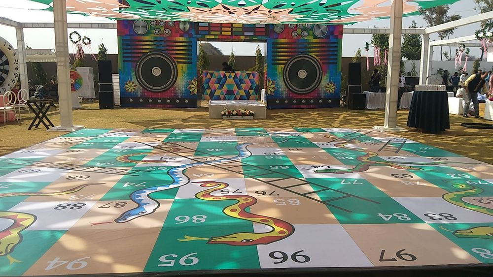 Photo of Giant snake and ladder game for guests.
