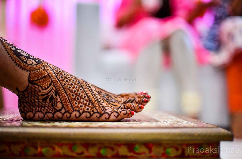 Photo of Bride feet mehendi shot