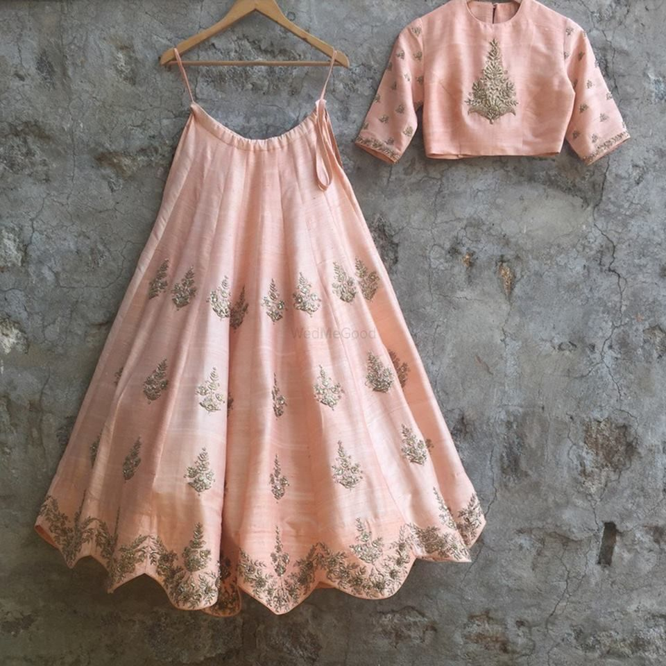 Photo of Scalloped edge lehenga in pastel pink with silver motifs