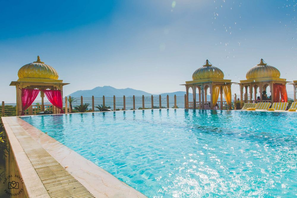 Photo of Poolside Venue with Gold and Pink Mandap Decor