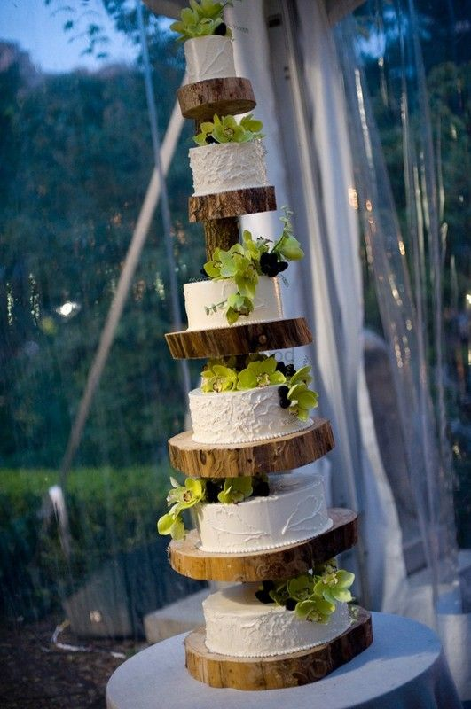 Photo of 6 tier rustic wedding cake with wooden barks
