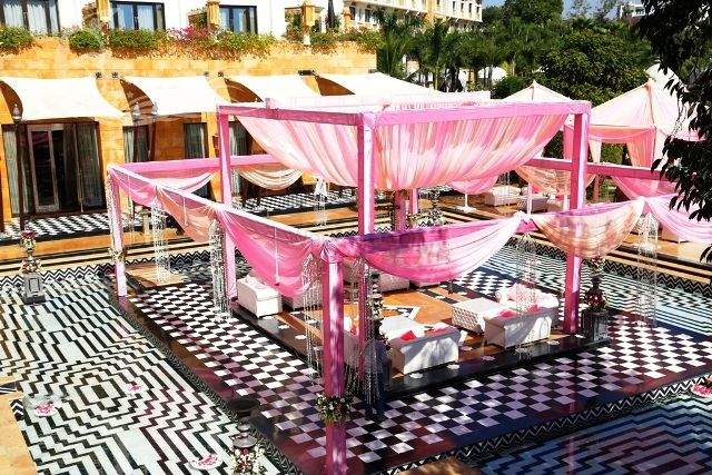 Photo of Pastel Pink mandap decor on checkerboard flooring