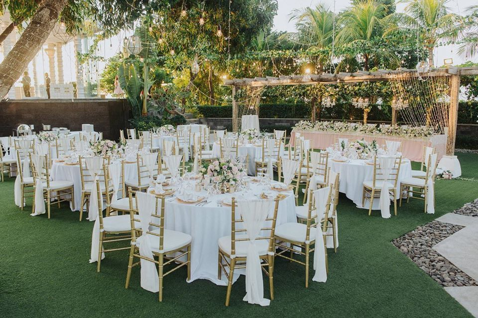 Photo of White table and chair setting decor.
