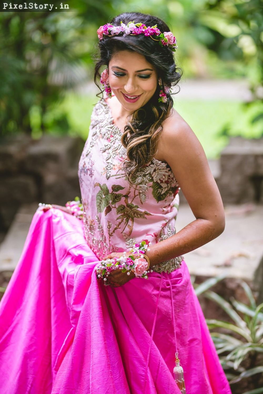 Photo of Mehendi hairstyle with floral wreath