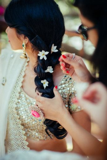 Photo of Side braid with white flowers for mehendi