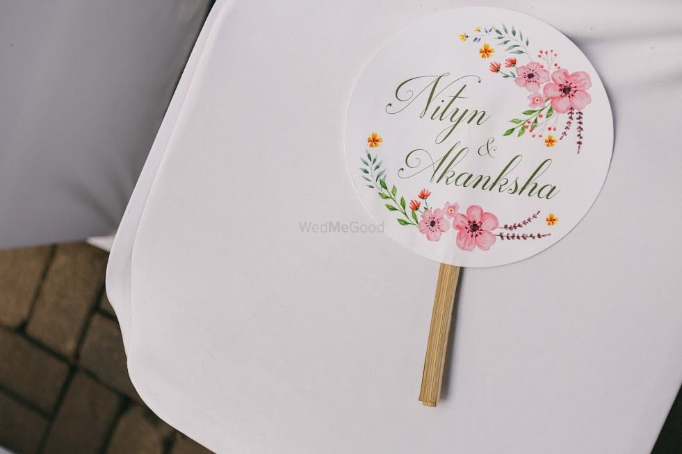 Photo of Hand fans on chairs for every guest